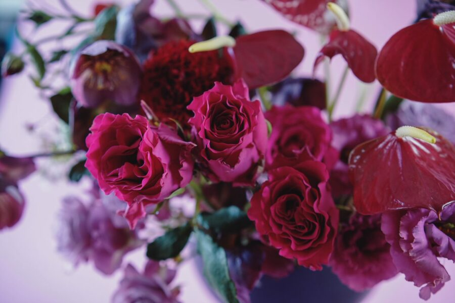 Autumn weddings, red, crimson and burgundy roses, anthuriums and hellebores