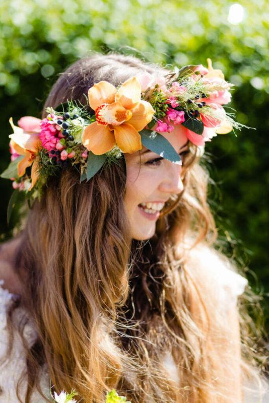 30 stunning ways to wear wedding hair flowers bright big and bold min 683x1024 1