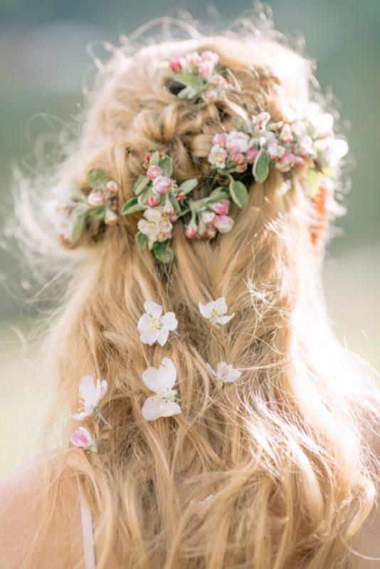 30 stunning ways to wear wedding hair flowers cascade of flowers min 683x1024 1