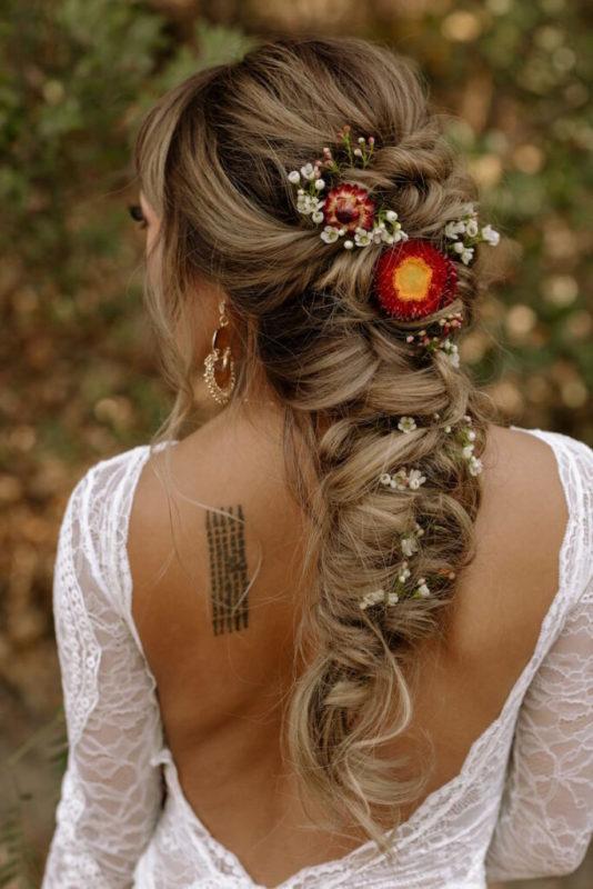 30 stunning ways to wear wedding hair flowers delicate budded fishtale min 683x1024 1
