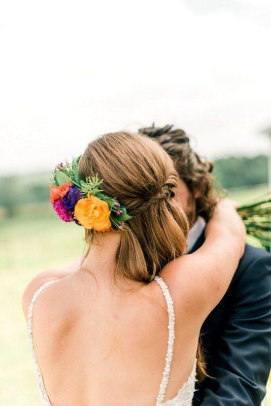30 stunning ways to wear wedding hair flowers pop of colour min 683x1024 1