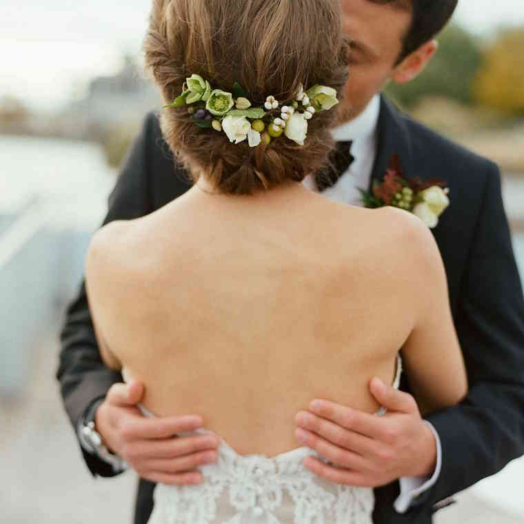 30 stunning ways to wear wedding hair flowers soft chignon with buds min