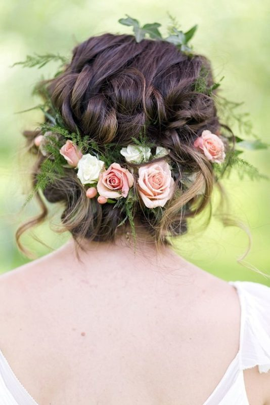 30 stunning ways to wear wedding hair flowers whimsical updo with roses