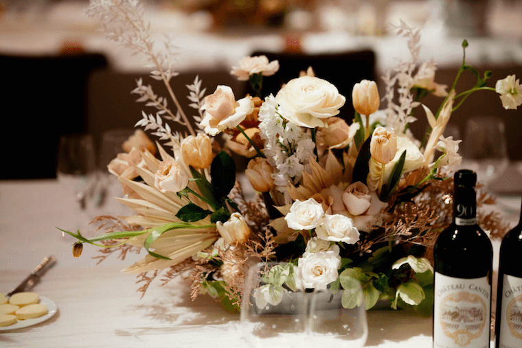 micro wedding roses and tulips table arrangements