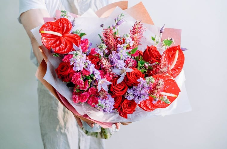 red and lilac bouquet by blooming haus