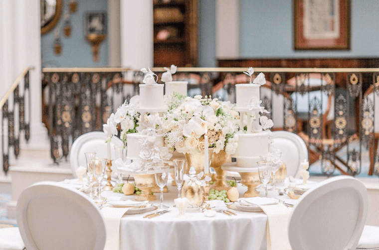 Wedding Flower Trends, white orchid and roses table arrangements at Lanesborough hotel in London